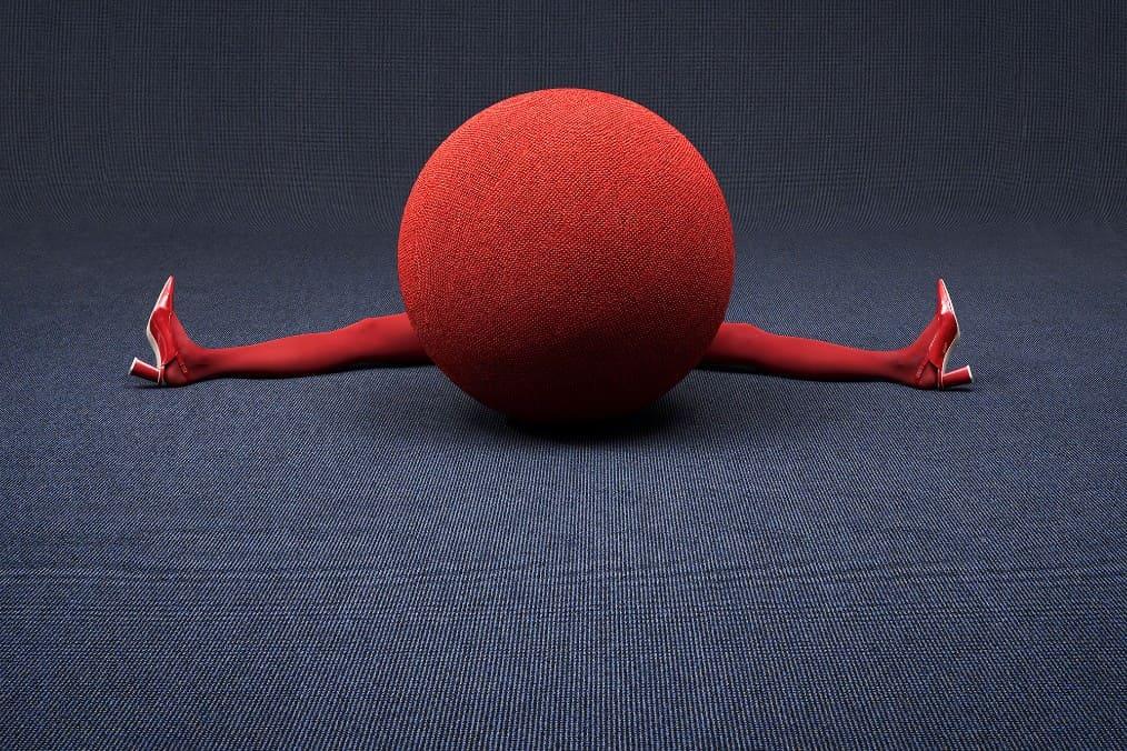 Roter Ball mit zwei Beinen im Spagat